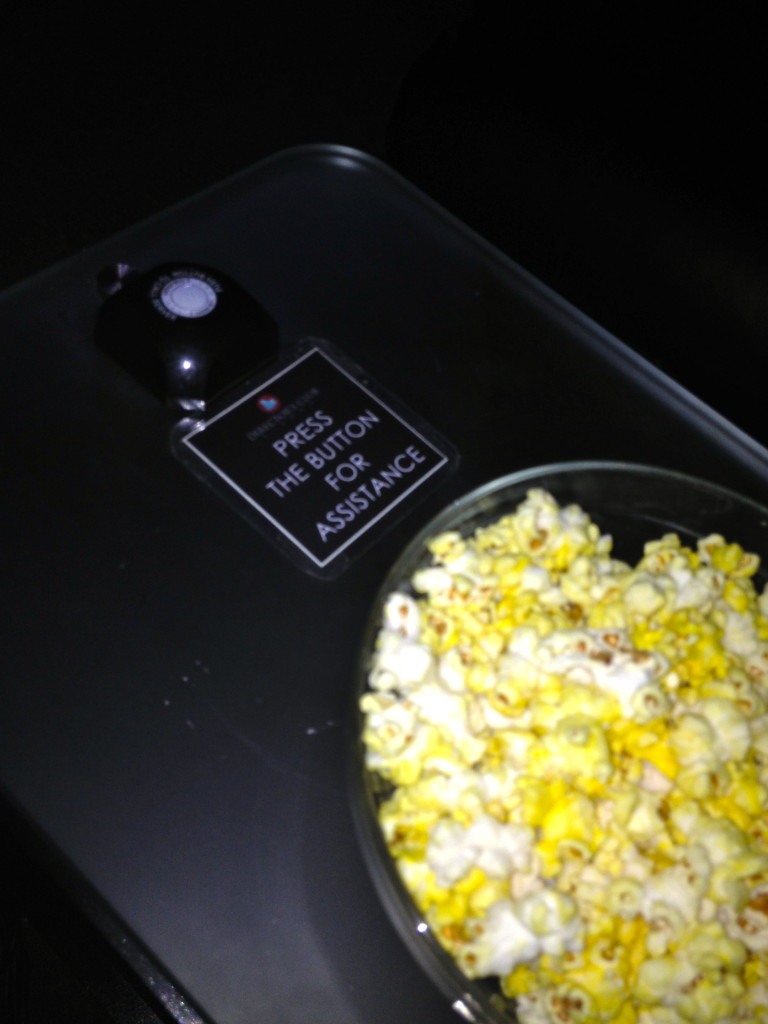 With a press of a button, there is a butler ready to take your order. Note: Popcorn is served in a glass bowl!