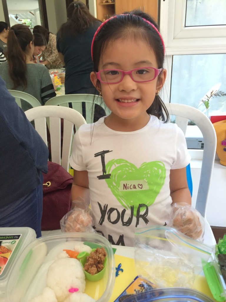 We didn't just have Moms in attendance! This little girl joined the workshop because her Mom knows that the only way to get kids to explore more foods and try new things is to have them help you make it! Congratulations Nika on making your first Bento Box Lunch!