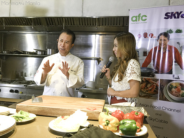 Chef Martin Yan with host Jamie Fournier before he begins his demonstration.
